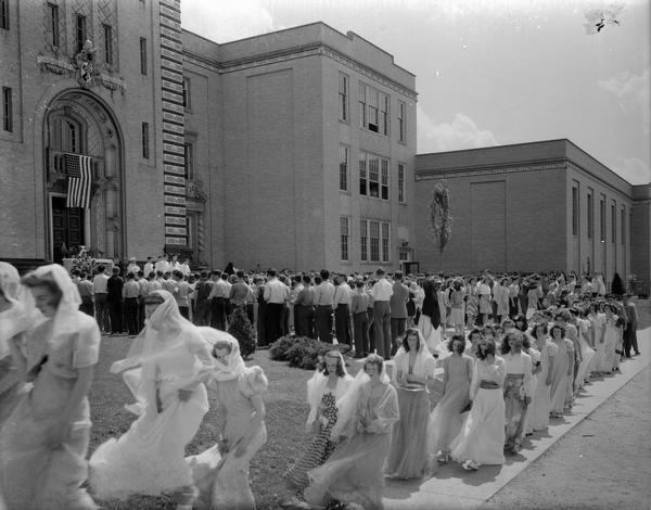 Students gathering in front of Edgewood High School, 1000 Edgewood Avenue, waiting for Mass to begin, with May Crowning procession in the foreground.