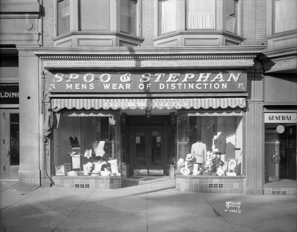 Spoo & Stephan, Inc., men's clothing store, 18 N. Carroll Street.