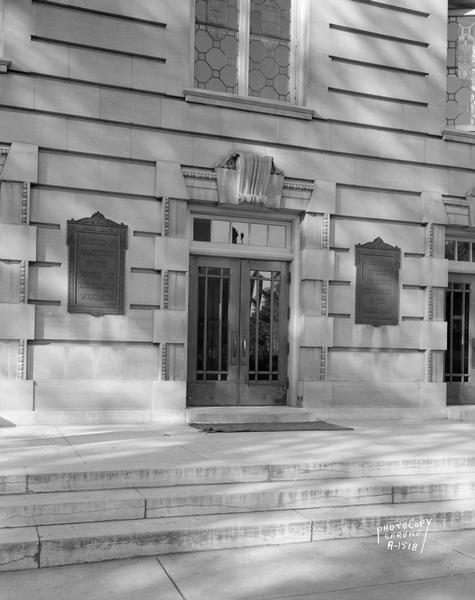 "Entrance to Wisconsin General Hospital, 1300 University Avenue, showing plaques on either side of doors which read: ""1920-1924 Erected in gratitude by the people of the State of Wisconsin, a memorial to those who served the country in the World War."""