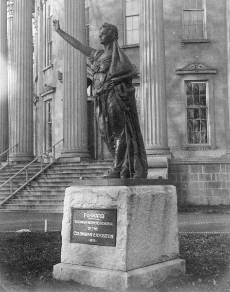 """Forward,"" the statue created by Jean Pond Miner of Wisconsin for the Wisconsin Women's Memorial at the Columbian Exposition in 1893.  The statue is seen on the grounds of the third Wisconsin State Capitol.  Behind the statue can be seen the swans neck ornamentation used on all first floor windows."
