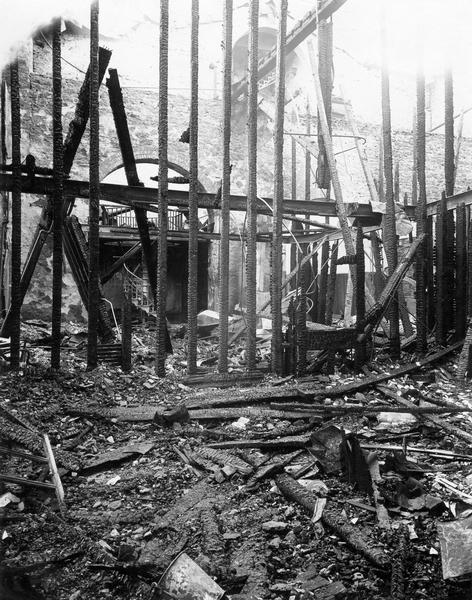 Ruins of the second floor of the North Wing of the third Wisconsin State Capitol, looking south, after the fire. The blaze nearly destroyed the entire building and led to the construction of the present Capitol.