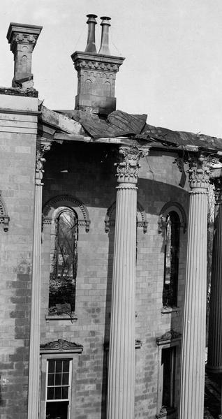 Damaged East Wing of the third Wisconsin State Capitol after the fire of February 27-28, showing details of the iron Corinthian columns, and the decoration of the windows and chimneys.