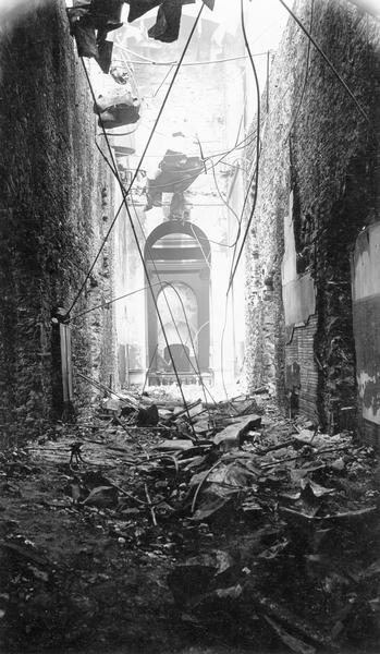 Second floor corridor of the South Wing of the third Wisconsin State Capitol, looking south, after the fire of February 27, 1904. The view is through the central Rotunda showing the balustrade around the gallery.