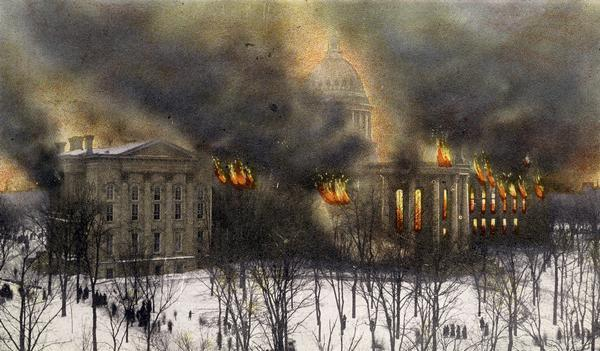 Postcard depicting the fire of February 26-27, 1904 that destroyed most of the second Wisconsin State Capitol. The smoke and flames have been dramatically enhanced by the postcard publisher.