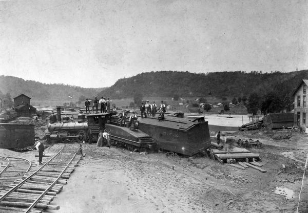 Elevated view of the Kickapoo & Northern Railway locomotive and cars seen here after being derailed due to flooding on the Kickapoo River.