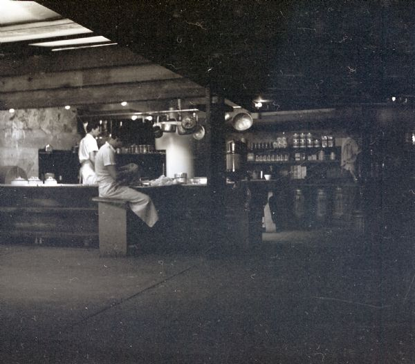 Three people working in the kitchen at Taliesin West, the winter residence of Frank Lloyd Wright.