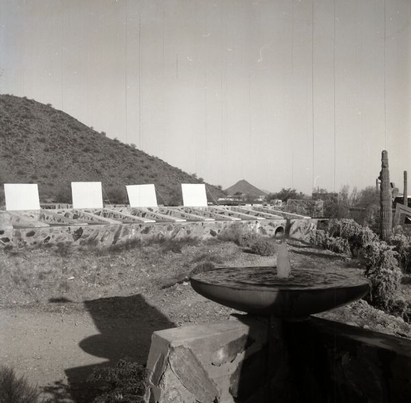 Fountain and garden at the entrance to Taliesin West, winter residence of Frank Lloyd Wright and the Taliesin Fellowship. Construction of the Cabaret Theatre can be seen in the background.