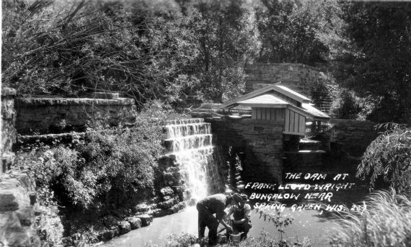 Men working near the dam and hydro house at Taliesin, the summer residence of Frank Lloyd Wright and the Taliesin Fellowship. The hydro house was designed by Wright. Taliesin is located in the vicinity of Spring Green, Wisconsin.