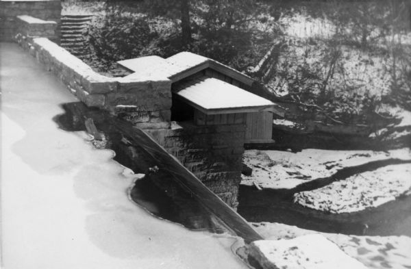The hydro house and dam at Taliesin, summer residence of Frank Lloyd Wright and the Taliesin Fellowship covered with snow. The hydro house was designed by Wright. Taliesin is located in the vicinity of Spring Green, Wisconsin.
