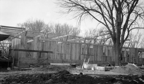 Construction of the Hillside drafting studio at the Taliesin Fellowship Complex. The roof trusses are in place and the walls and window openings for the apprentice rooms are complete. The studio was designed by Frank Lloyd Wright and was a drafting studio for the Taliesin Fellowship. Taliesin is located in the vicinity of Spring Green.