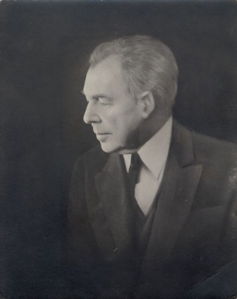 Quarter-length portrait of Frank Lloyd Wright in middle age.