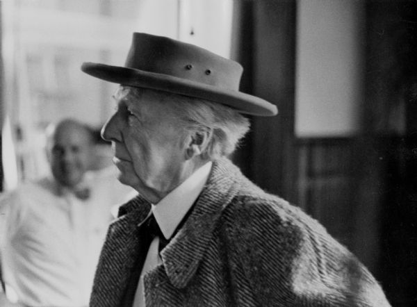 Frank Lloyd Wright, wearing a hat, at the WHA television station.