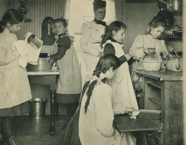 Students in cooking class at Hillside Home School, an early progressive school, operated by  Ellen and Jane Lloyd Jones, aunts of Frank Lloyd Wright.
