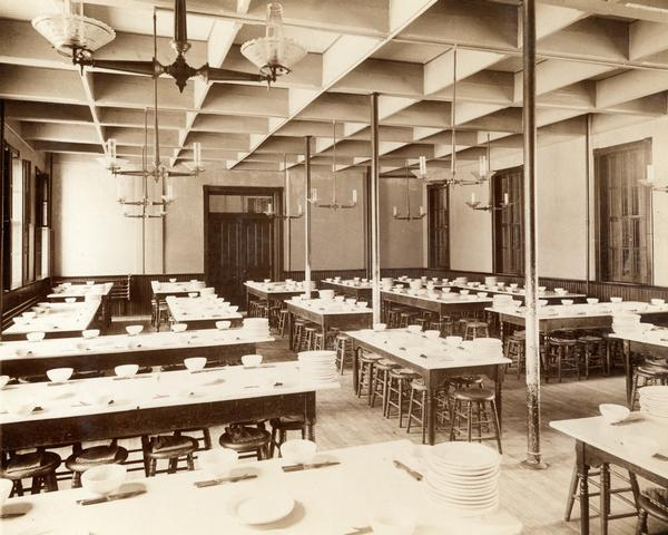 Dining hall at the State Public School, with numerous tables and place settings.