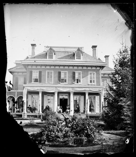 Home of Governor Cadwallader C. Washburn on Monroe Street at the east end of what is now the Edgewood College campus. Washburn is probably the man at left.