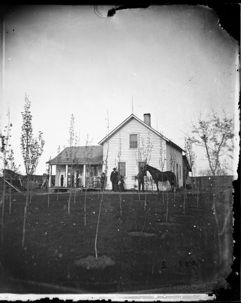 Family in front of Wing Frame House   Photograph   Wisconsin ...