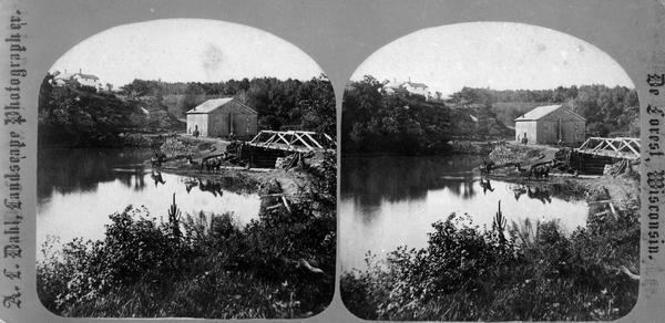 View of a bridge, dam and mill. Moscow was platted in 1850 by an Englishman, Chauncy Smith, who dammed the Bluemound branch of the Pecatonica River to run a grist mill. It was settled by English, Irish, German and Norwegian immigrants.