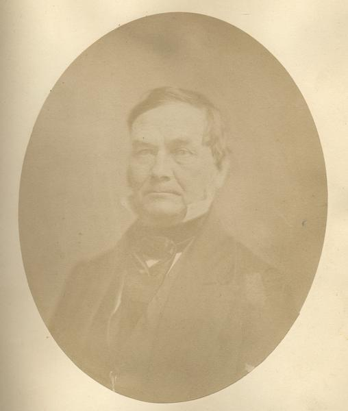 Quarter-length oval portrait of Henry L. Baird.  He was born in Ireland and came to Wisconsin in July of 1824.  Baird resided in Green Bay and was 45-years-old at the time of the photograph.