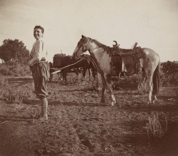 A woman, possibly Sarah Jones, the wife of William Arthur Jones, with a horse.