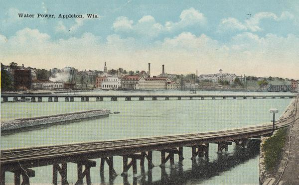 "Fox River with a view of Appleton in the background.  Postcard reads ""Water Power, Appleton, Wis."""