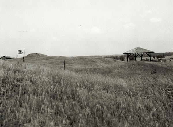 View of the site when it was known as Aztalan Mound Park or Aztalan Mounds, near Lake Mills. There is a pavilion in the right background.
