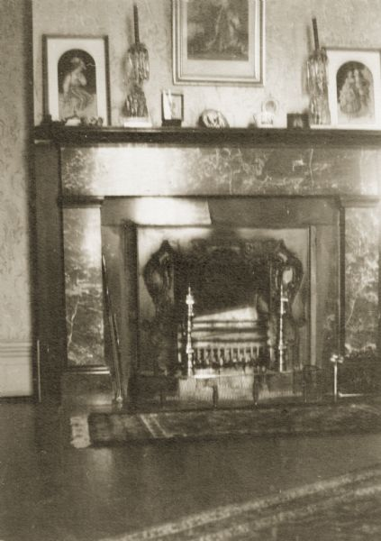 View of a fireplace and mantle in Hazelwood, the home of Morgan L. Martin. Morgan Lewis Martin served as county judge of Brown County from 1875 until his death in 1887.