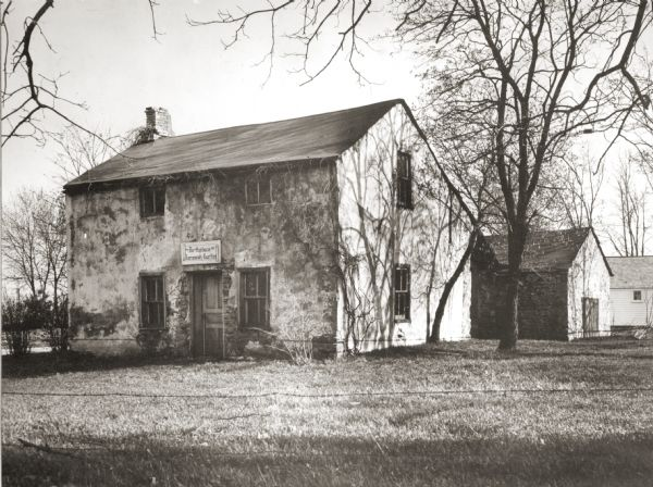 View of the Jeremiah Curtin house located at 8685 West Grange Avenue. This stone and stucco residence was erected in 1835.  It has been recognized as the boyhood home of linguist and mythologist Jeremiah Curtin.