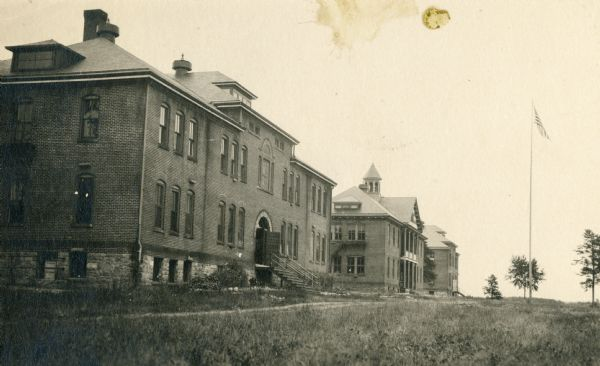 View of the Hayward Indian School, including the boys' building, chapel and schoolrooms, and the girls' building.