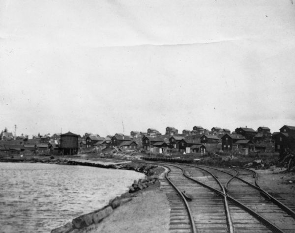Star Lake, Arbor Vitae Township, with the railroad tracks of Chicago, Milwaukee and St. Paul Railway on right and lake on the left.