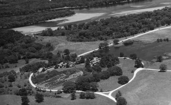 Aerial view of Taliesin, Frank Lloyd Wright's residence and architectural school complex, with the  Wisconsin River visible at the top. Taliesin is located in the vicinity of Spring Green, Wisconsin.