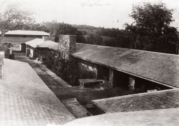 Elevated view of Taliesin, Frank Lloyd Wright's residence and studio as it appeared early 1912 before the hexagonal clerestory windwo was added adjacent to the studio fireplace in the fall of 1912 or the spring of 1913.