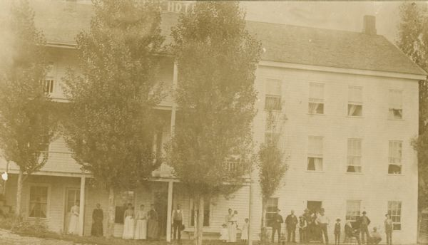 Exterior view of the St. Croix House with people lined up outside.