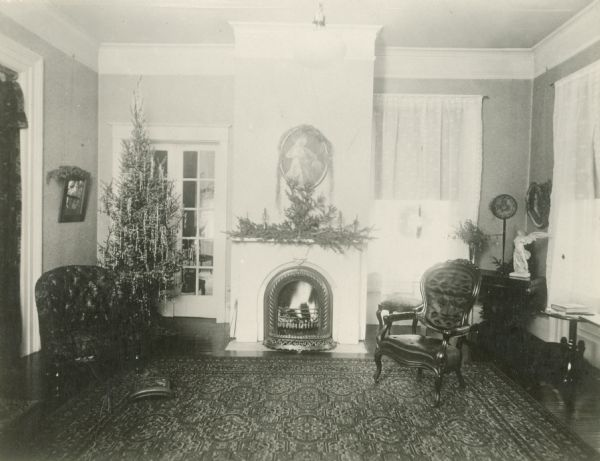 Israel Greene Beaumont's House, located at 203 South Jefferson Street.  The front parlor has a Christmas tree near the hearth.