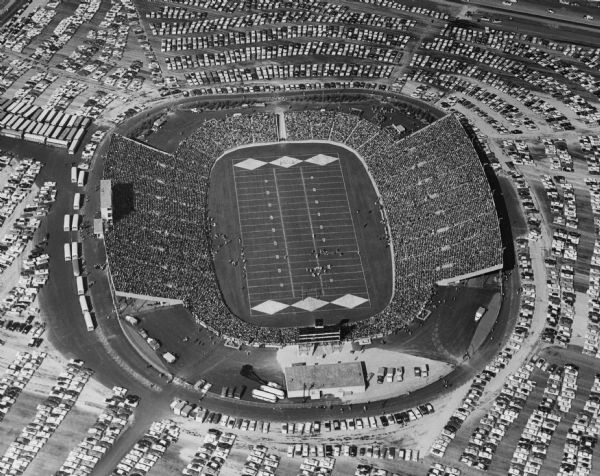 Aerial view of Lambeau Field (known as City Stadium from 1957 to 1965), home the Green Bay Packers football team, with a full parking lot. The capacity of the stadium at the time of this photograph was over 50,000.