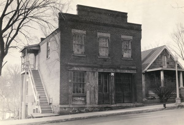 View from across street of the Washburn and Woodman Bank building, erected by C.C. Washburn and Cyrus Woodman. The bank was established in 1846 and operated until 1855.