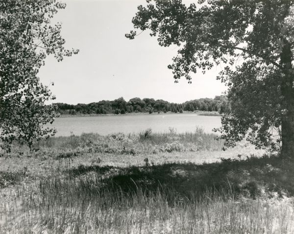 View of Ennis Lake, also known as Fountain Lake, located in the John Muir Memorial Park near Montello. As a boy, John Muir lived with his family on the shores of Fountain Lake from 1849-1857. Muir Park, which is owned by Marquette County, was named a State Natural Area in 1972 and Fountain Lake Farm was designated a National Historic Landmark on June 21, 1990.