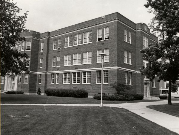 A view of the south-west corner of Swart Hall, at the University of Wisconsin-Oshkosh. This building was built in 1928, and was originally known as Rose C. Swart Training School.  In the entrance hallway, across from the front doors, a mural of the construction of Swart Hall is preserved.
