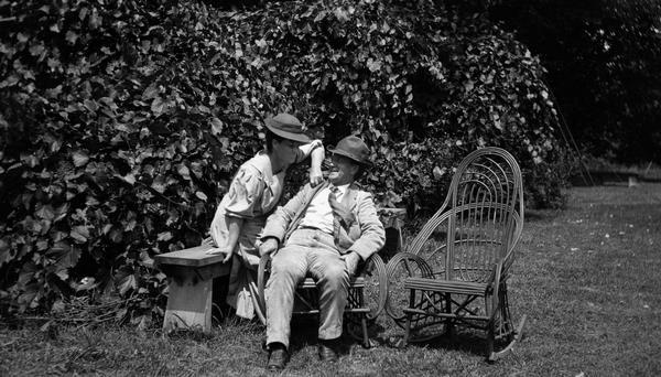 Belle Case La Follette and Senator Robert M. La Follette, Sr., at Maple Bluff Farm. They are photographed during a relaxed moment in the yard.