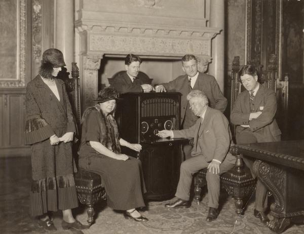 Robert M. La Follette, Sr., with Isabel Bacon La Follette (Mrs. Philip La Follette), Mrs. John J. Blaine, Philip Fox La Follette, Governor John J. Blaine, and Robert M. La Follette, Jr., listening to radio reports of the 1924 election returns in the Executive Chamber in the Wisconsin State Capitol. Senator La Follette was an independent, third-party presidential candidate in the election.