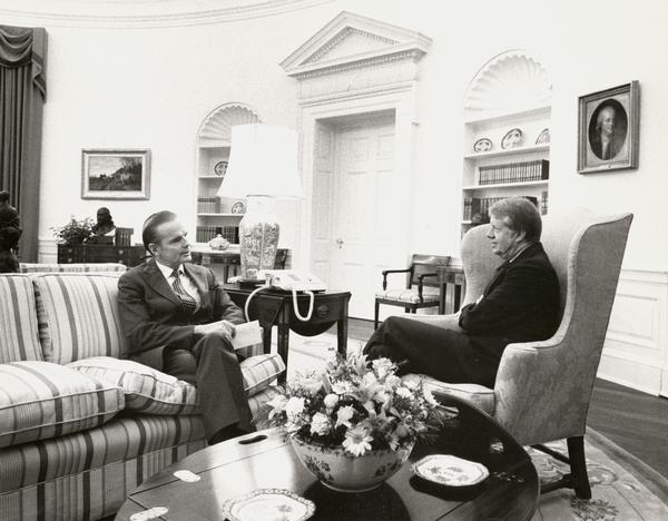 Senator William Proxmire meeting with President Jimmy Carter in the White House.