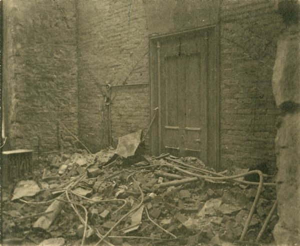 "Interior damage to the Wisconsin State Capitol following the fire of 1904.  The original photomount had the annotation: ""Where my desk stood at the time of the Capitol fire, Feb., 1904."""