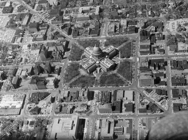 Aerial view of the Wisconsin State Capitol and surrounding area. The view is looking northwest, with King Street on the bottom right, and S. Hamilton Street on the bottom left.