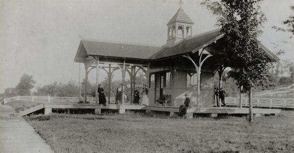 "Lakeside station near ""Water Cure.""  The Lakeside Water Cure, in today's Olin Park on the south side of Lake Monona, was completed in August 1855.  Patients were treated in the steam-heated main building, which accommodated 80.  On August 21, 1877, the facility burned and was not rebuilt."