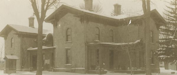 "Simeon Mills (farm) residence, 2709 Sommers Avenue. This Victorian Italianate residence was built from local sandstone in 1863. Mills, an early Madison settler and a prominent figure in commercial and governmental activities, lived here until 1868. The property was once known as ""Mills Folly"" for being located so distantly from the center of town.  Later residents included J.W. Hudson, a leading industrialist, and Sam Miller, a nationally known opera and theater promoter. The house was added to the National Register of Historic Places in 1987."