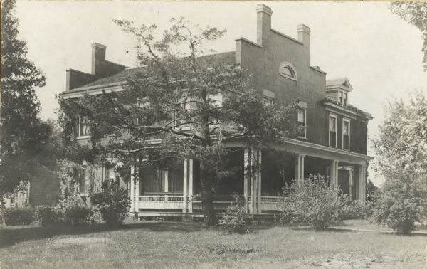 Exterior view of the residence of Mrs. M.S. Rowley on University Avenue, opposite the University of Wisconsin-Madison Chemistry building.