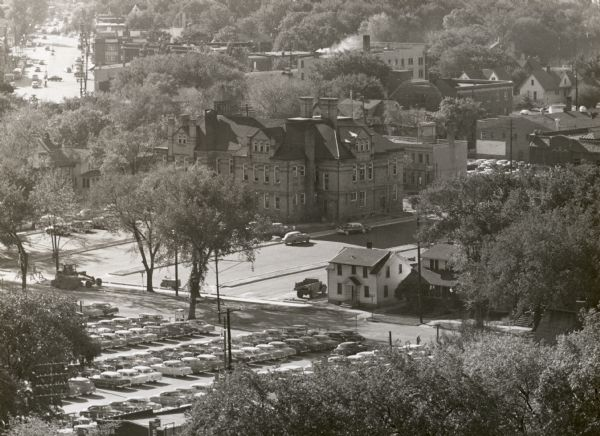View looking west at Washington School, located at 217 North Broom Street. From the early 1940's until its demolition in 1957, the school was used as the Dane County Courthouse Annex. During this time its address was listed as 353 West Johnson Street.