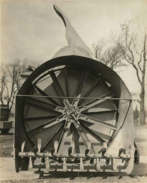 Front end view of a rotary snowplow used on mountain passes, manufactured by the Winther Motor and Truck Company.