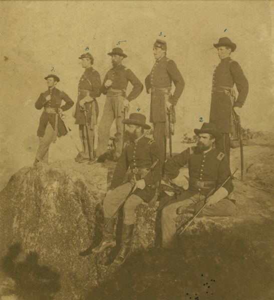 The Twenty-First Wisconsin Volunteer Infantry posing on Lookout Mountain.  (From right to left) Fred W. Borcherdt of Manitowoc, Wisconsin; acting Adjutant Company D, later Captain of Company E.  Albert B. Bradish of Neenah, Wisconsin; First Lieutenant, later Captain of Company L.  Rudolph J. Wiesbrod of Oshkosh, Wisconsin; Captain Company E.  Bartholomew J. Van Valkenburg of Two Rivers, Wisconsin; Quartermaster.  John Henry Otto of Appleton, Wisconsin; Captain Company D. Alfred A. Harding of Waupun, Wisconsin, Second Lieutenant Company G.  James E. Stuart of Oshkosh, Wisconsin; Captain Company B.
