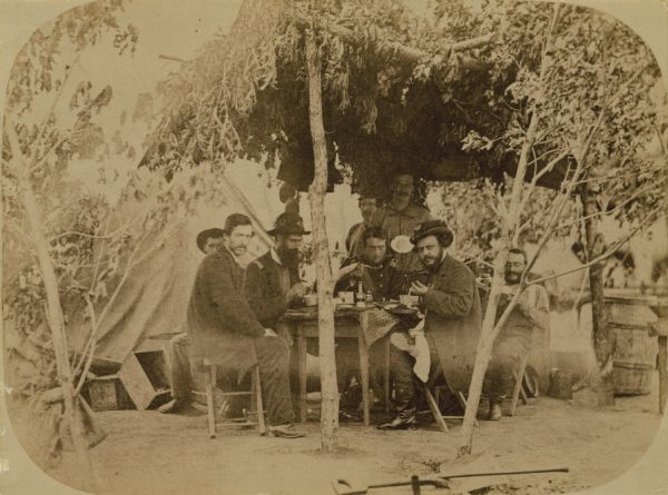Second Wisconsin Volunteer Infantry officers' mess. Pictured are: Surgeon A.J. Ward, Major Thomas S. Allen, Lt. Colonel Lucius Fairchild, and Colonel Edgar O'Connor, as well as a butler, a cook, and other staff.