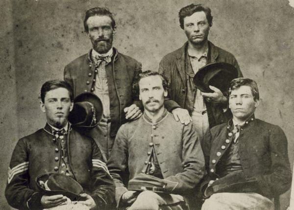 Five members of the 1st Wisconsin Infantry, Company C, who enlisted in 1861, were captured at the Battle of Chickamauga, and escaped together from a Confederate prison. From left to right standing: Joseph Leach and Lemuel McDonald. From left to right sitting: Chauncey S. Chapman, Thomas Anderson, and John R. Schofield. This photograph was probably taken after their escape, when they were reunited in Cincinnati at the soldiers' home there.